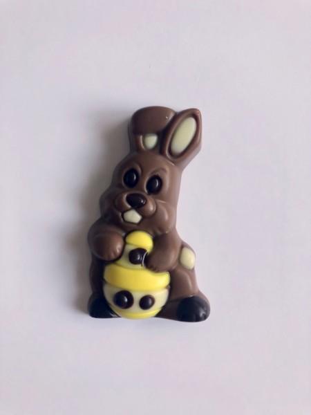 """""""Hase mit Ei"""" Schokoladenrelief 10g"""