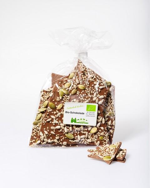 BIO-Vollmilchschokolade mit BIO-Sesam, -Kürbis- und Sonnenblumenkernen